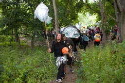 Penny Couchie (Aanmitaagzi) leads the fish. Photo: Giulio Muratori.