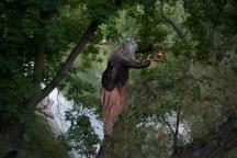 Salmon Woman (Jani Lauzon) pours the gathered rivers into the Wonscotonach. Photo: Giulio Muratori.